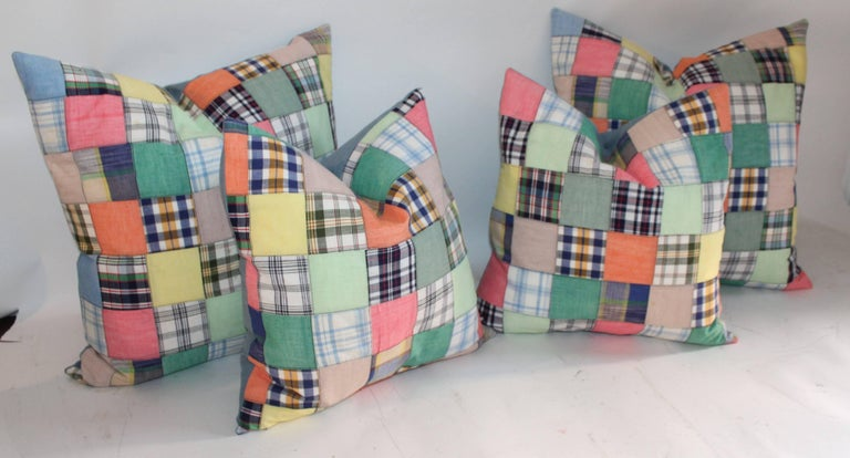 These two pairs of quilt patch pillows are made from hand made quilt top and are backed in blue cotton linen. We are selling the collection as one.  Smaller pillows measure 17 x 17 Larger pillows measure 22 x 22.