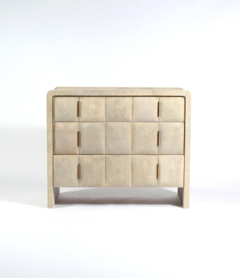 The quilted chest of drawers in cream shagreen is a beautifully detailed piece with its shagreen round beveled drawers and clean lines. The thin bronze-patina brass handles allow for practically while maintaining the incredible aesthetic of the