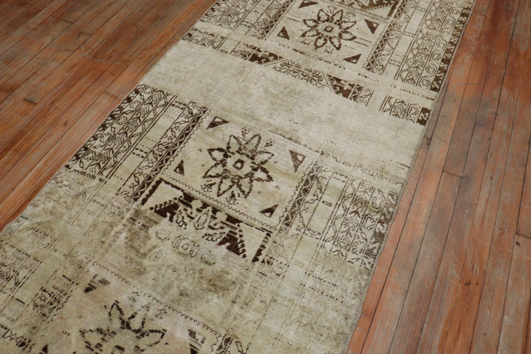 A quirky Turkish Sivas runner in creams and brown. The striation of browns and beige are referred to as abrash which are natural color variations found in some vintage and antique rugs from the 20th century, circa 1940.  Measures: 3'2