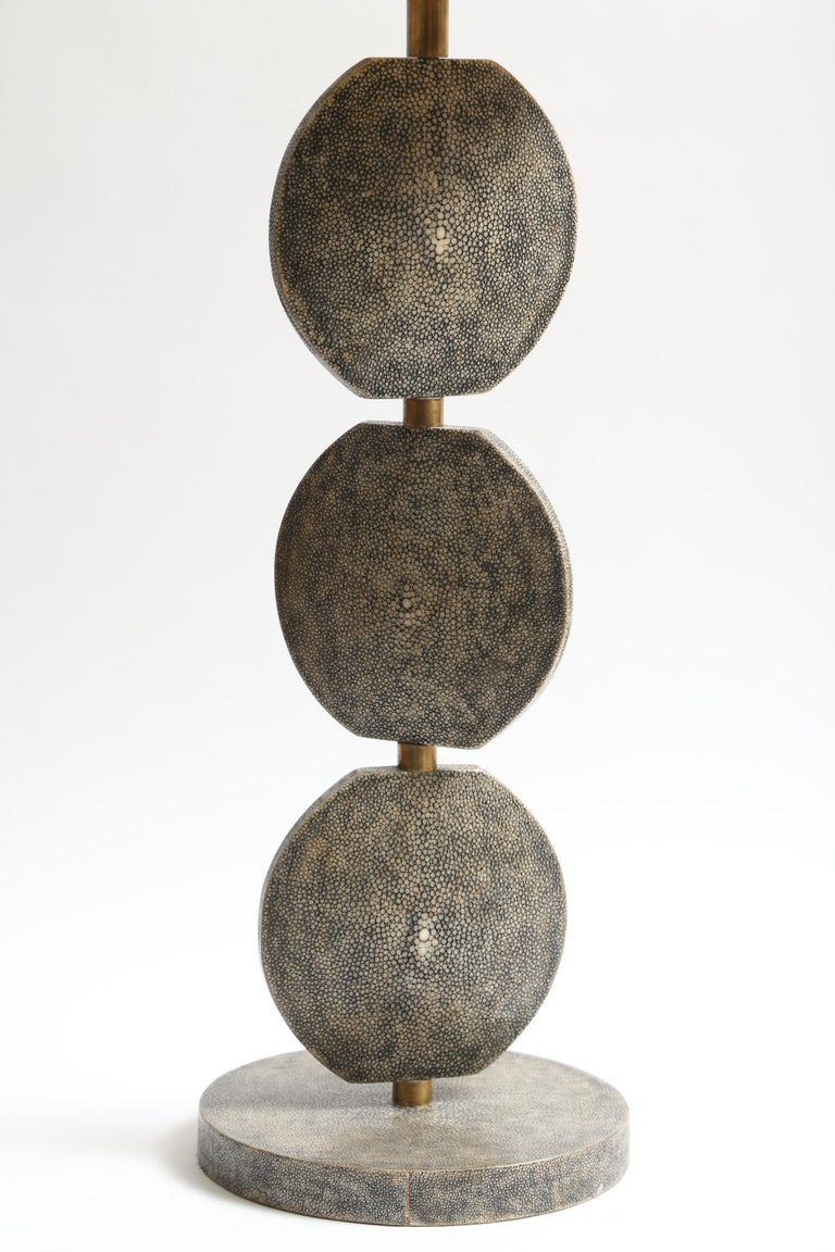 A fine example of R and Y Augousti. The disks can be manipulated 365 Degrees. Another Augousti lamp in Lizard skin is also listed.