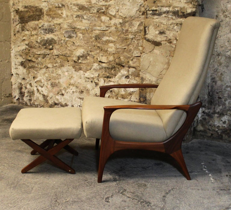 R. Huber teak reclining lounge chair with ottoman. This has been newly re-upholstered and both the chair and ottoman adjust to multiple positions for better comfort.  Scandinavian Modern / Mid-Century Modern.