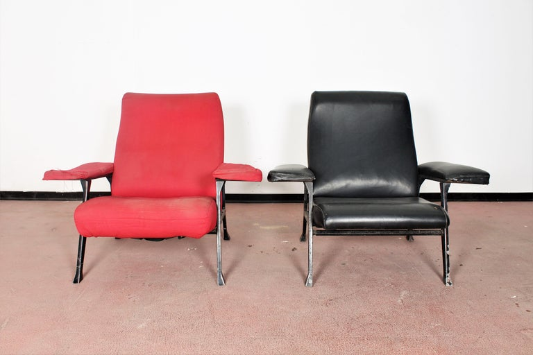 Roberto Menghi by Arflex, Italy, 1958 two armchairs in stamped metal, foam rubber padding on nastrocord. One of the two armchairs is covered in red fabric, while the other one in black skai leather. Wear consistent with age and use.  literary