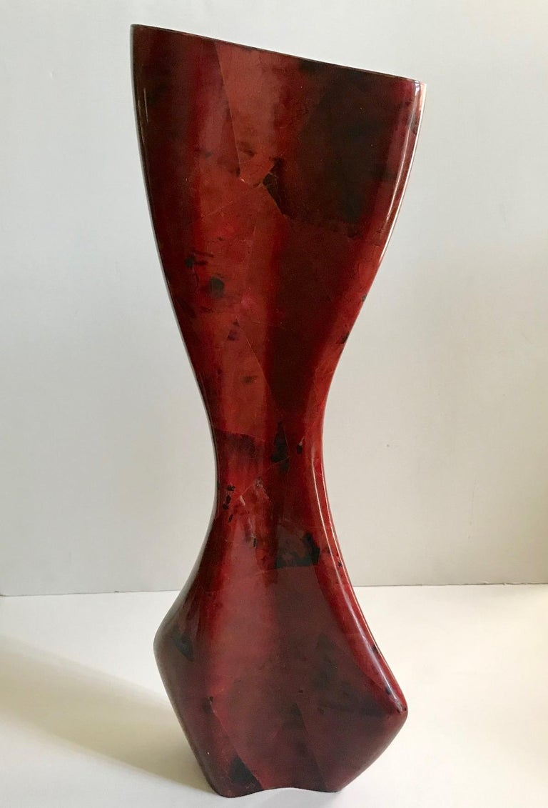 Exceptional organic modern vase with sculptural abstract form. Handcrafted from exotic materials featuring lacquered pen-shell inlays with geometric patterns in red and black. Comprised of pen-shell over palm wood and stamped with R & Y signature.