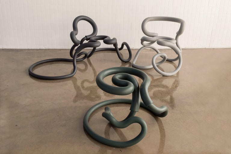 Aranda\Lasch continues to explore and test out various furniture forms from their latest Railing series, a series of design pieces that utilize bent tubes and furnished with leather of foam outside. Railing chair (R1 and R2) and railing stool (R3)
