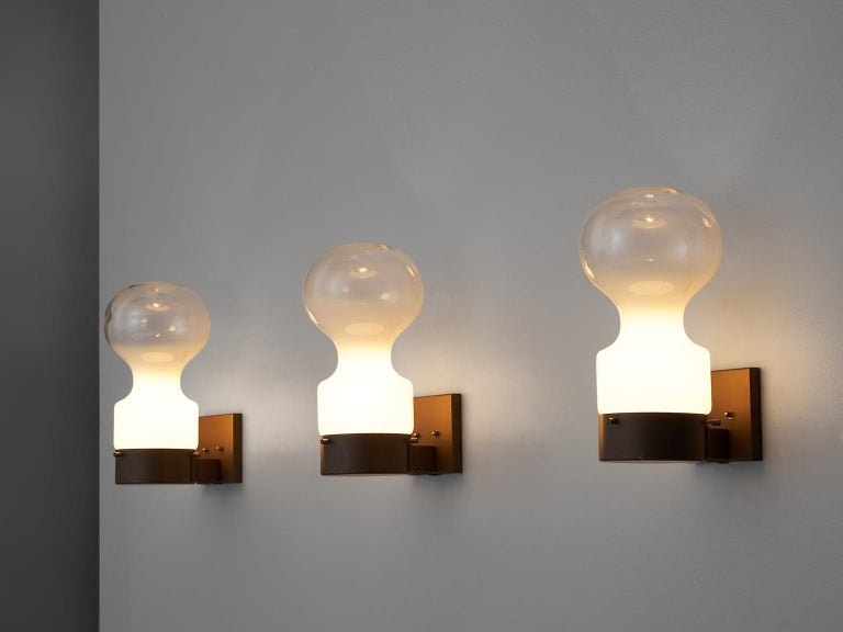 RAAK Amsterdam, dew drop wall lights, glass, iron, The Netherlands, 1960s.  This set of six wall lights is designed by RAAK Amsterdam. The frame is made of brown iron and the bulbs are made of glass. The bottom half of the shade is opaque and the