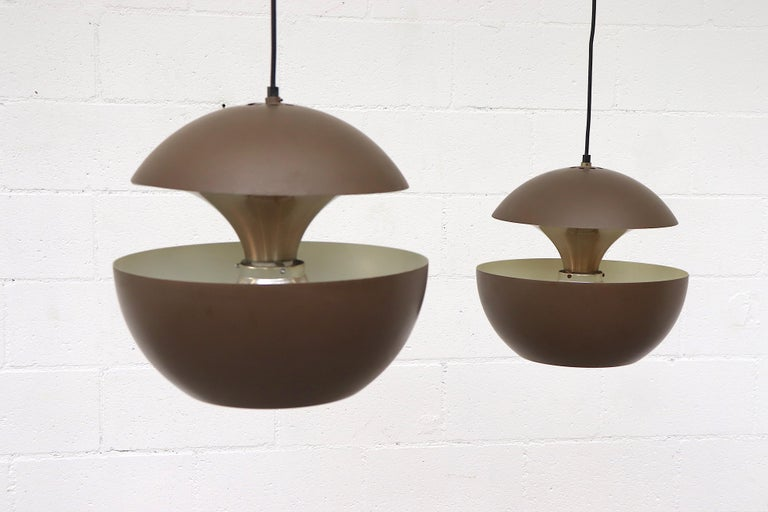 RAAK 'Springfontein' ceiling pendant with brown enameled aluminum shade on aluminum hardware with sleek modern design. In overall good original condition with visible wear and scratching consistent with age. May have some denting. Individually