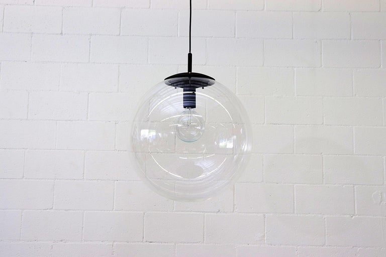 Jumbo clear acrylic globe lights with clack enameled hardware and standard light socket. In original condition. Shot with G40 bulb.