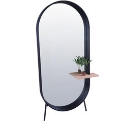 Racetrack mirror, contemporary floor mirror with shelf by Pat Kim.