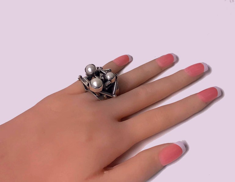 Rachel Gera Abstract Modernist Sterling Ring, Israel, C.1975. Open abstract form set with three cultured silver white pearls. Signed on underside Gera 925 Israel Hand Made. Rachel Gera, born Tel Aviv and educated at Jerusalem's Bezalel Academy of