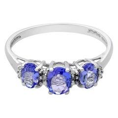 Rachel Koen 14 Karat White Gold Oval Tanzanite and Diamond Three-Stone Ring