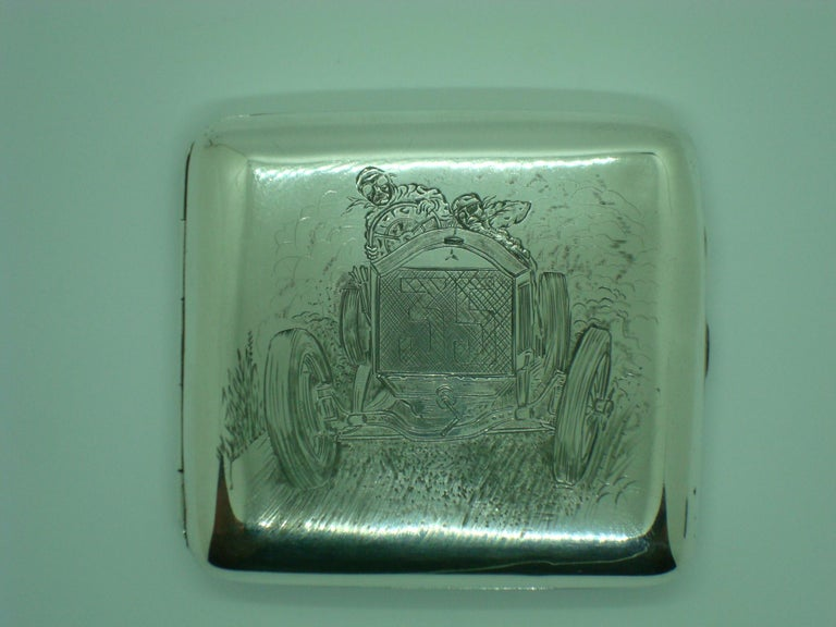 A magnificent and extremely rare sterling silver engraved cigarette case depicting a stylized Racing car. The car has the emblem of Mercedes Benz. Marked UK Birmingham Sterling silver, Henry Clifford Davis 1918. A beautiful and exceptionally rare