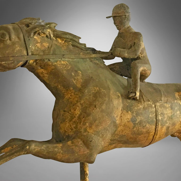 Molded copper and zinc weathervane with gilding. The surface is untouched showing great warm patina. This style of racing horse was named 'Kentucky and Jockey' weathervane in the J.W. Fiske Company catalog Attributed to the J.W.Fiske Company, circa
