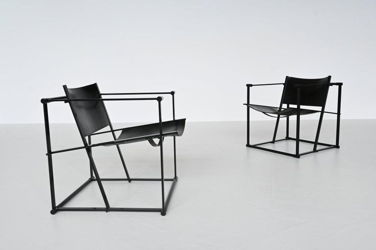 Beautiful minimalistic pair of cubic lounge chairs model FM61 designed by Radboud Van Beekum and manufactured by Pastoe, The Netherlands 1980. These very nice geometrical shaped chairs have a black coated metal structure and black thick saddle