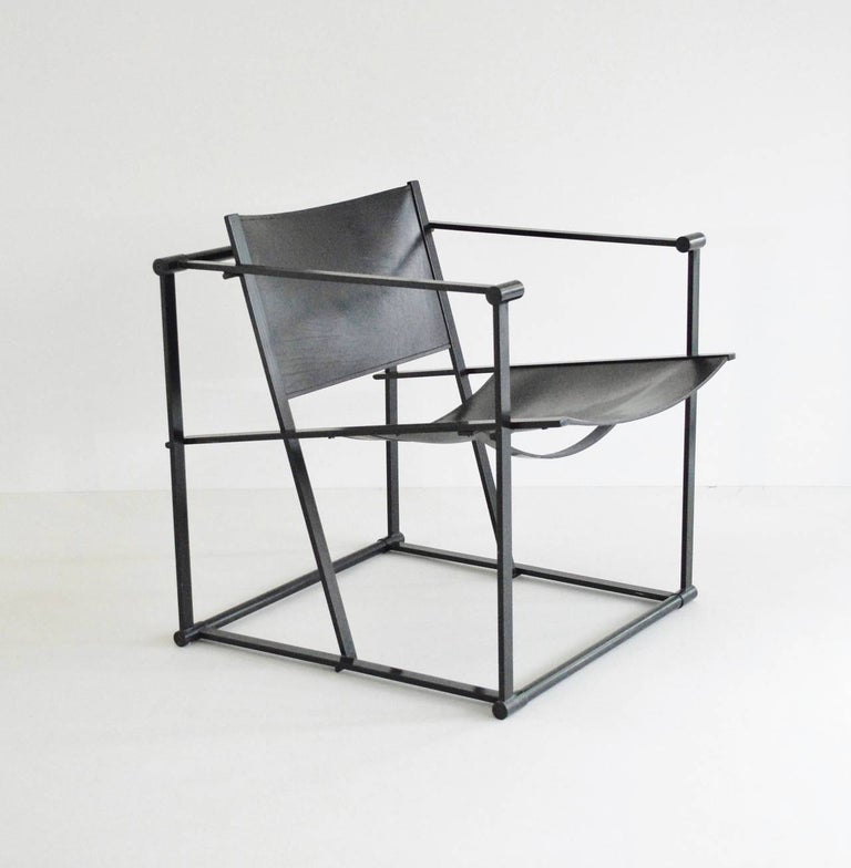 A geometric chair constructed from folded black steel with slung black leather seating. Following in the tradition of the De Stijl movement the FM60 / FM61 / FM62 model cube chairs were inspired by the designs of Gerrit Rietveld. The Cube chair was