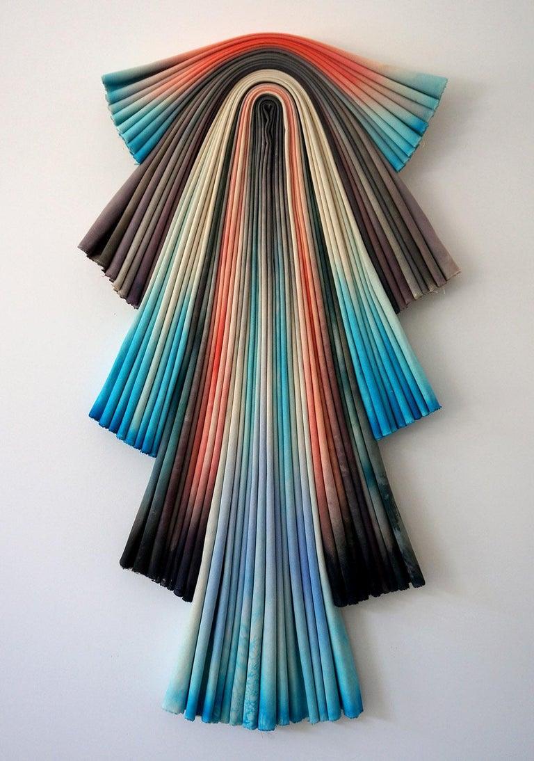 Painted folded canvas wall sculpture.