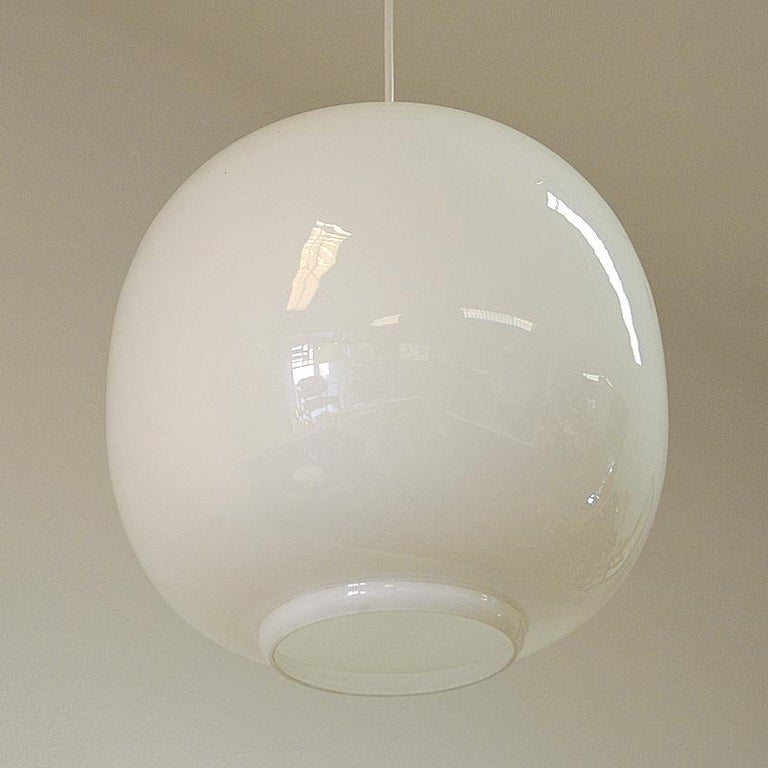 This opaline glass pendant lamp is the same model as the original radio house pendant from the 1940s named VL45 Radiohus Pendel. The Radiohus pendel was created in conjunction with the Radiohouse in Copenhagen. The author was Vilhelm Lauritzen, one