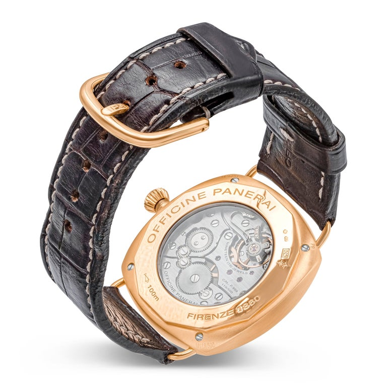 This watch an Officine Panerai Radiomir Firenze 1860 Watch with the 42mm case and bezel made of 18k rose gold. Brown dial with luminous baton hour markers with seconds marker at the 9 o'clock area. Luminous arabic numerals for 3, 6, and 12 o'clock