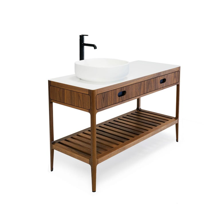 This freestanding bathroom vanity designed and fabricated by Munson Furniture draws inspiration from midcentury designs and fits beautifully with both traditional and contemporary interiors. The dimensions and functionality can all be customized to