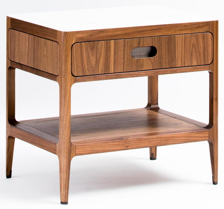 This walnut side table or nightstand designed and fabricated by Munson Furniture draws inspiration from mid-century designs and fits beautifully with both traditional and contemporary interiors. We've started with our signature table design and