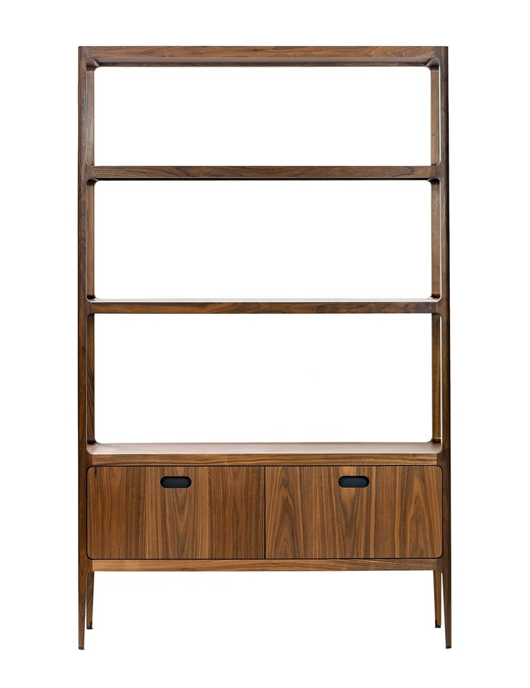 One of the largest pieces in the Radius collection by Munson Furniture, this customizable shelving unit has a modern esthetic that fits beautifully with both traditional and contemporary designs and can be used as a bookshelf, display case or bar.