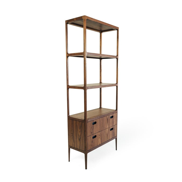 This shelving unit draws inspiration from midcentury designs and fits beautifully with both traditional and contemporary interiors. Designed by Munson Furniture to be used as a bookshelf, display case or bar, the dimensions are all customizable. As