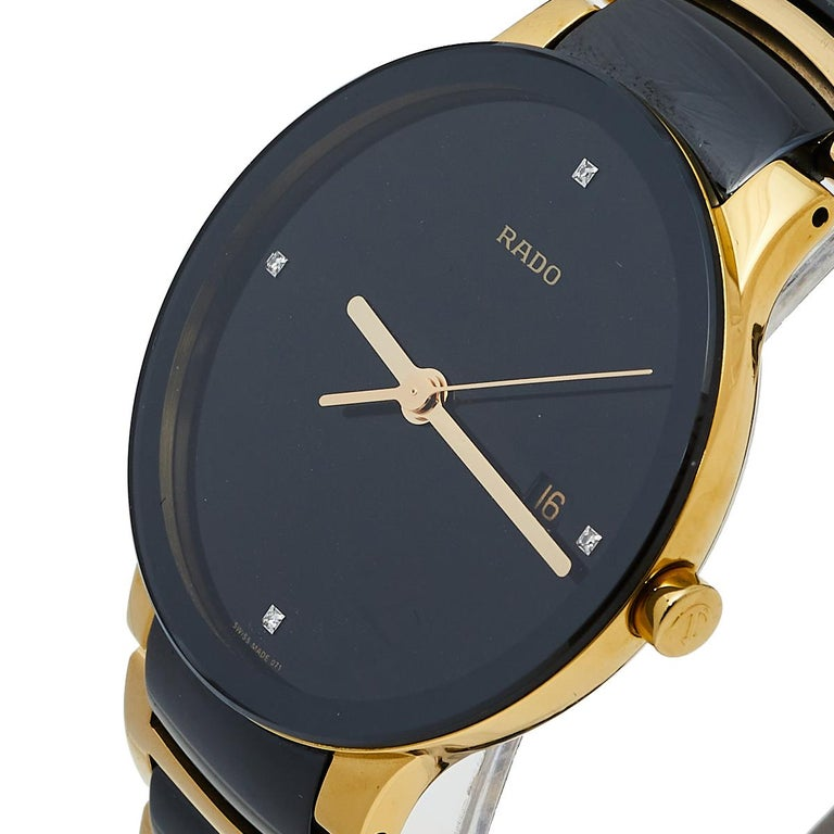 This wristwatch from Rado is elegance represented in a subtle fashion. Created from PVD-plated stainless steel, this watch flaunts a round case. It follows a quartz movement and has a black dial with stud hour markers, three hands, a date window,