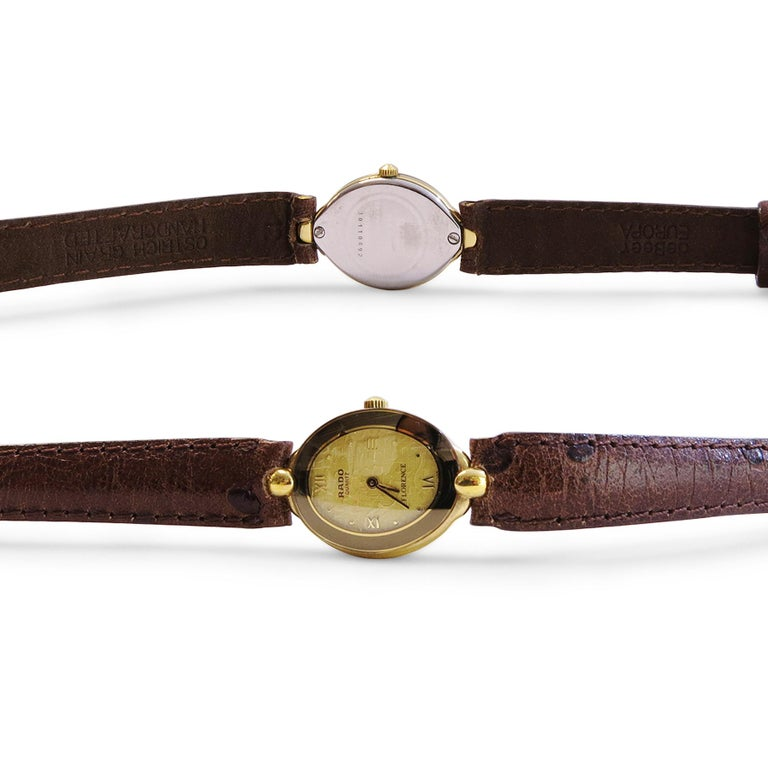 Rado florence watch  With Ostrich Band Handcrafted Quartz Movement  Oval shape  Buckle= Original Band not original  Diameter= 19mm x 26mm 18k gold Plated