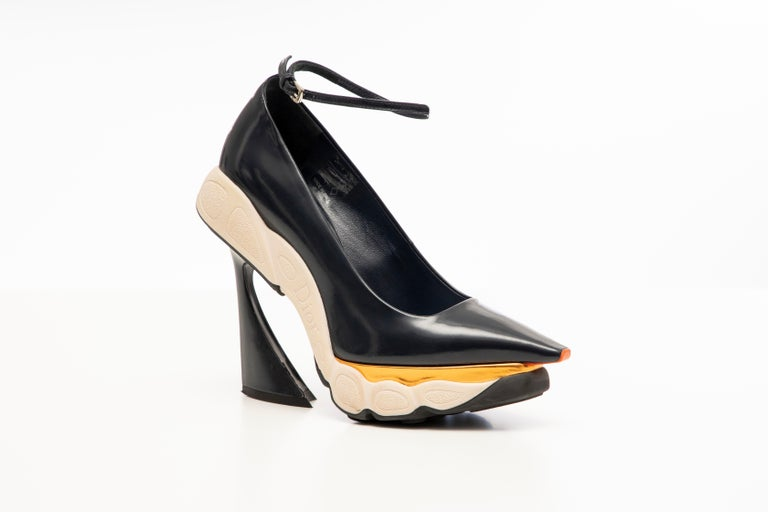 Raf Simons for Christian Dior, Fall 2014, navy blue, patent leather, pointed-toe runway sneaker pumps with copper-tone metallic leather accents, rubber soles, covered heels with ankle straps.  IT. 36 US. 6  Heels: 4.25