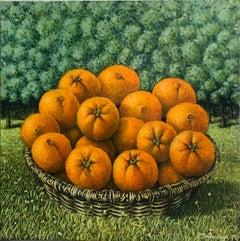 Basket Of Oranges In The Landscape