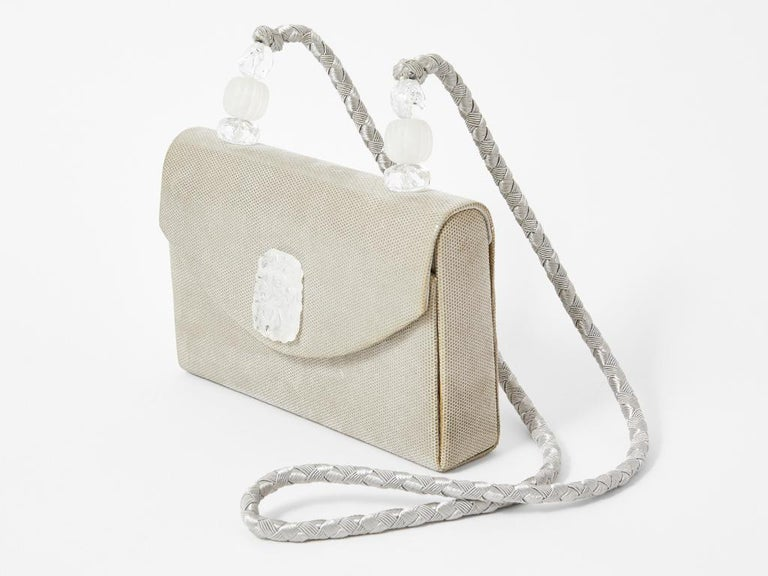 Rafael Sanchez, pearlized suede, evening bag with carved lucite, Lalique inspired accents. Braided cord strap.