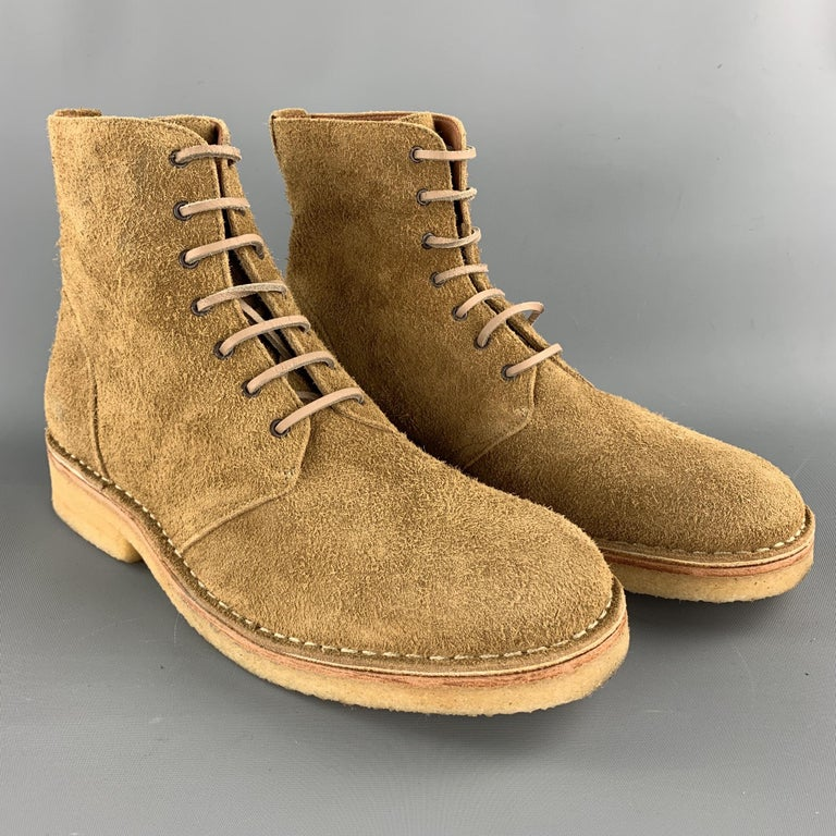 Men's RAG & BONE ankle boots comes in a tan textured suede featuring a military lace up style and a crepe sole. Comes with box. Minor wear. Made in Portugal.  Very Good Pre-Owned Condition. Marked: EU 43  Measurements:  Length: 12 in.  Width: 4 in.