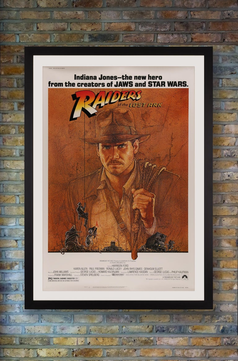A rare US 40 x 60 poster for the original release of 'Raiders of the Lost Ark' featuring Richard Amsel's iconic illustration of Indiana Jones with his whip slung over his shoulder. Conceived by producer George Lucas and directed by Steven Spielberg