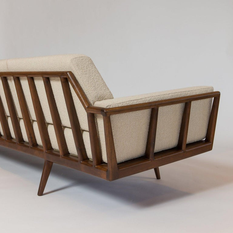 Originally designed by Mel Smilow in 1956 and officially reintroduced by his daughter Judy Smilow in 2013, the Rail Back Sofa is classically midcentury. This collection's sculpted wooden frames gracefully envelop you, providing for a comfortable and