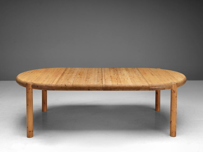Rainer Daumiller, extendable dining table, pine, Denmark, 1970s  Robust dining table in solid pine, designed by Rainer Daumiller. A functional design that features a rounded tabletop when not extended and an oval top when the two leaves are added to