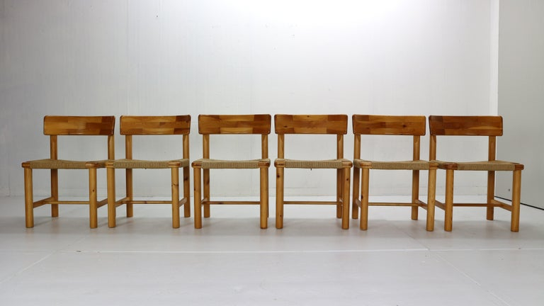 Sculptural, beautiful organic shaped dining chairs in pine wood and paper cord by Rainer Daumiller, manufactured for Hirtshals Sawmill, Denmark in 1970s. Beautifully carved organic lines of grained pine-wood frame and paper cord seating gives the