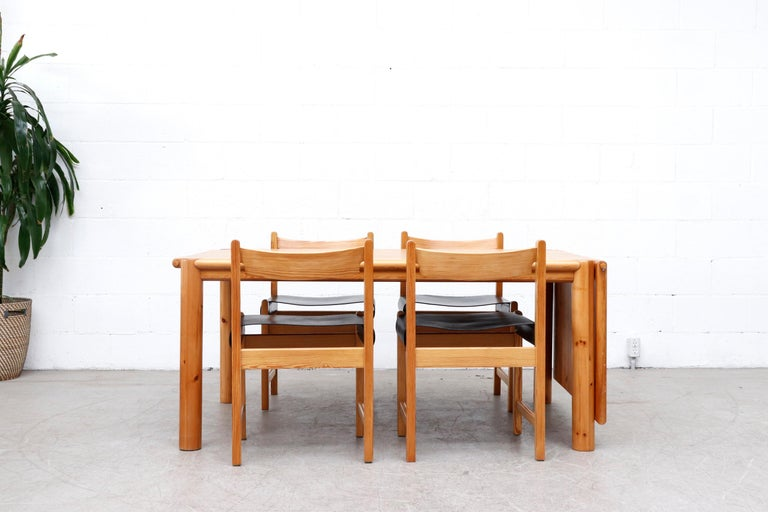 Gorgeous pine dining table by Rainer Daumiller for Hirtshals Savvaerk, Denmark. Lightly refinished rectangle dining table with one single removable leaf and fat round legs. Leaf can be placed on either side of the table with matching wood pegs. In