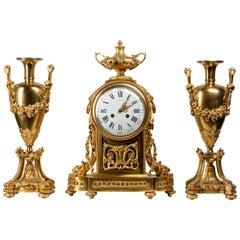 Raingo & Frères Neoclassical Ormolu Clock, Three-Piece Set with Vase Garniture