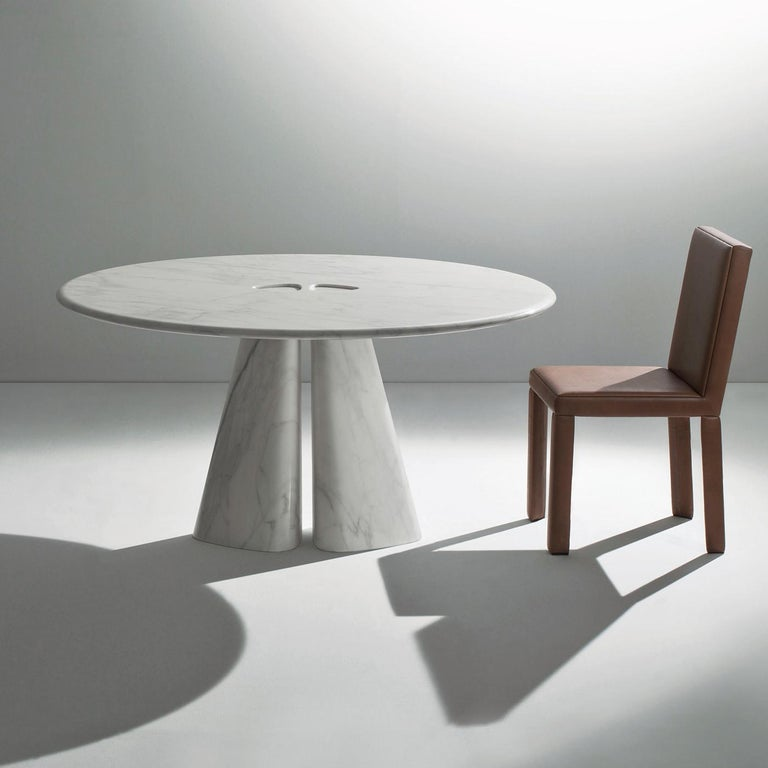 This unique table, designed by Bartoli Design, is entirely made in precious white Calacatta marble and is comprised of a two-element base that joins the round top with a Minimalist yet sophisticated design that combines the finest material with a