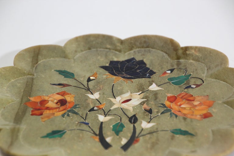 Rajasthani inlaid marble decorative plate in Pietra Dura work. Inlaid with semi precious stone handcrafted marble inlaid with semi precious stones, jasper, carnelian for orange. It is the same craftwork that you see in the Taj Mahal. Very nice fine