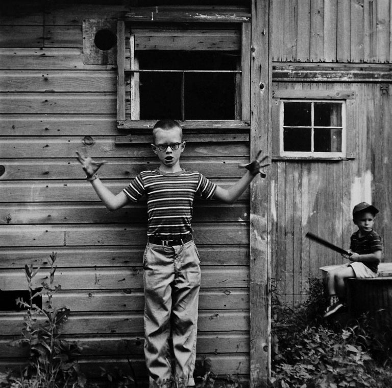Ralph Eugene Meatyard Portrait Photograph - Untitled (Boy Making Gesture) [Michael and Christopher]