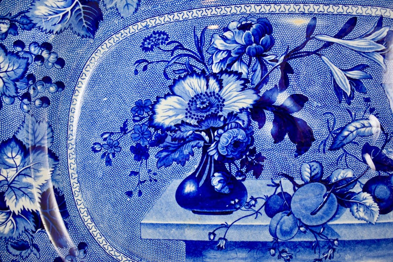 A blue on white, stoneware Staffordshire 'Coronation' pattern, well and tree platter by Ralph & James Clews, 1814–1834, Cobridge, Staffordshire, England.  19th Century  The title commemorates either the coronation of George IV in 1821 or William IV