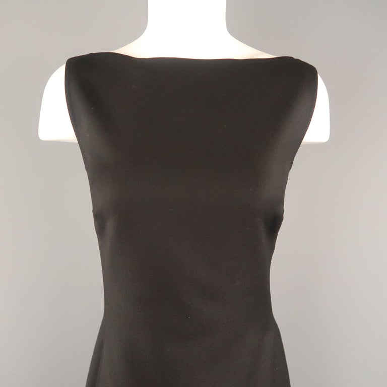 RALPH LAUREN BLACK LABEL sleeveless shift dress comes in black wool twill with a boat neck and A line silhouette. Made in USA.   Excellent Pre-Owned Condition. Marked: 8   Measurements:   Shoulder: 14 in. Bust: 38 in. Waist: 32 in. Hip: 40