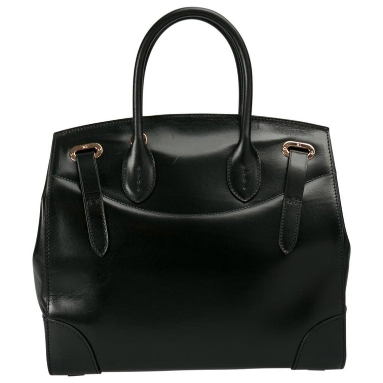 This Ralph Lauren Ricky bag is simply breathtaking. Meticulously crafted from leather, the bag delights not only with its appeal but structure as well. It is held by two top handles, detailed with gold-tone hardware and equipped with a spacious
