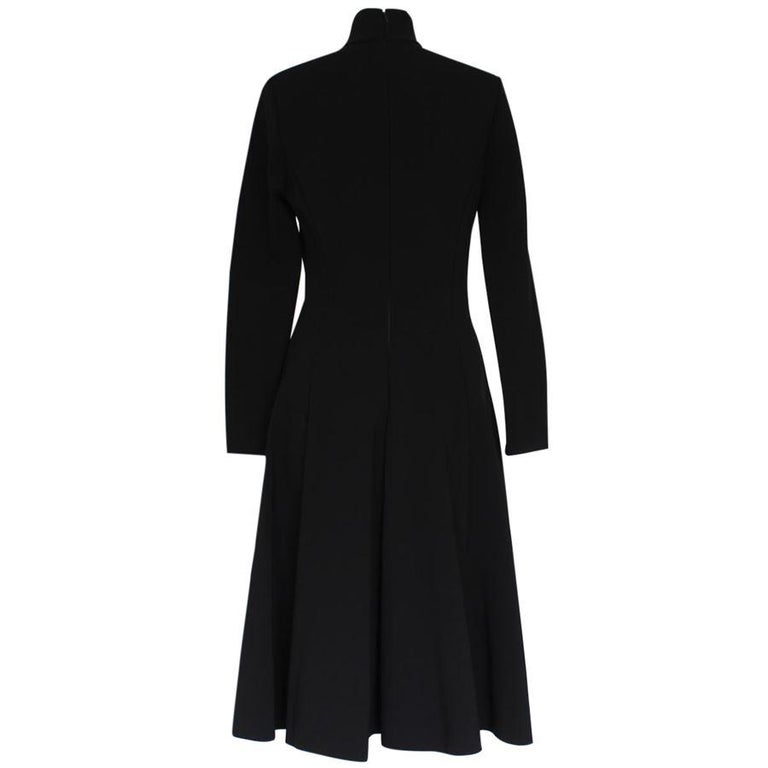 Fantastic long dress by Ralph Lauren Collection Viscose (75%) Poliamide (17%) Elasthane Black color Long sleeves High neck Zip on sleeves Total length cm 109 (42.9 inches) Shoulders cm 44 (17.3 inches) Italian size 44, american size 8 Original price