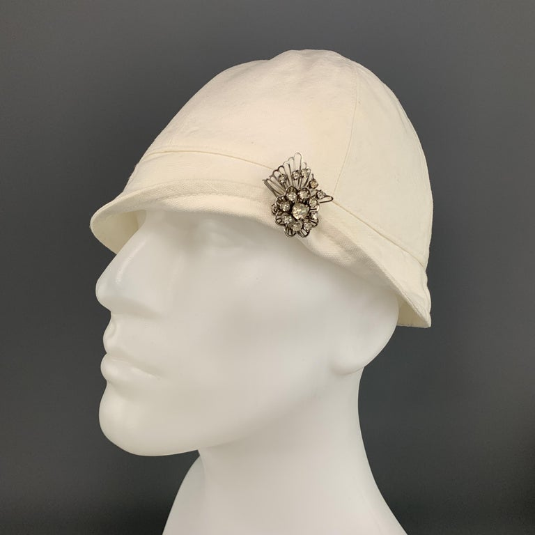 Vintage RALPH LAUREN COLLECTION PATRICIA UNDERWOOD 1920's cap comes in cream canvas with a silver tone rhinestone brooch.  Excellent Pre-Owned Condition.  Measurements:  Opening: 23 in. Brim: 1.5 in. Height: 6 in.
