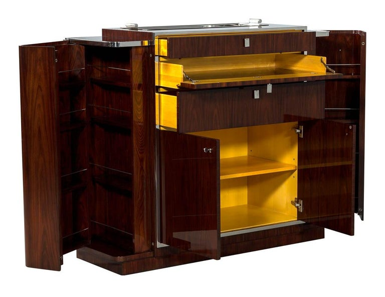 Ralph Lauren Duke Bar Cabinet. 1930s inspired bar cabinet is styled in rich woods with polished stainless steel trim.  Price includes complimentary curb side delivery to the continental USA.