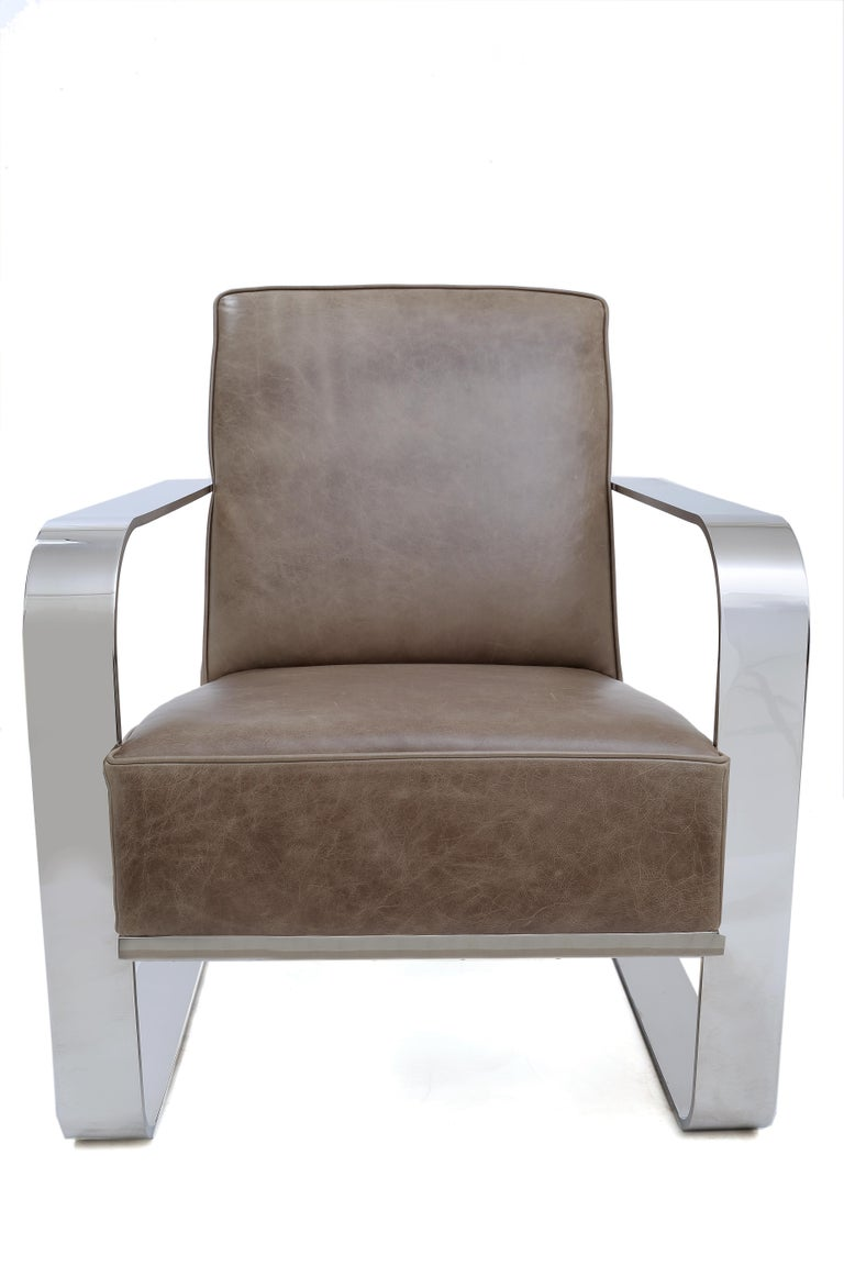 Polished chrome frame and upholstered vintage greige tight back/seat leather cushions. Designed by Ralph Lauren, this armchair is an iconic occasional piece to add to your living room, bedroom or office. Finishes: mirrored stainless