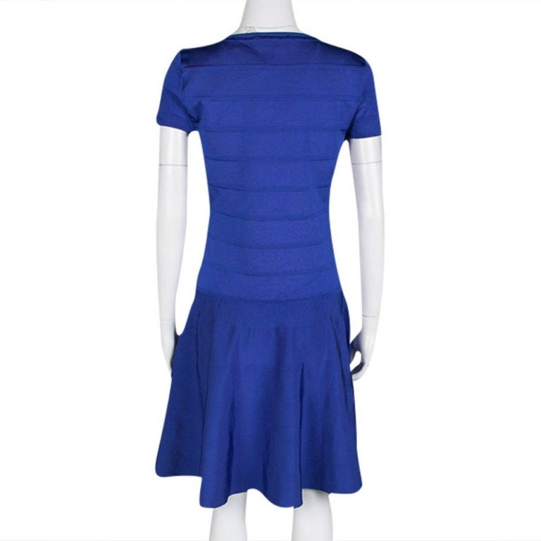 Ralph Lauren's Bandage dress is the epitome of wearable feminity. Designed in a true skater style, this blue outfit has a fitted, paneled bodice with fluid bottom featuring loose pleats. It has short structured sleeves and an impressive v-neckline.