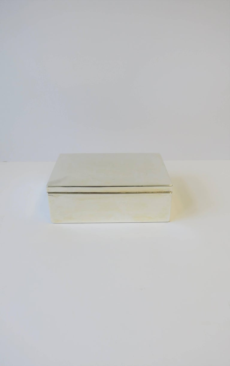 A beautiful Ralph Lauren silver plated teak wood lined box with an easy open/close. Box is a nice size, measuring over 9 inches wide, and can offer many uses; i.e., jewelry, money, tobacco, etc. Marked