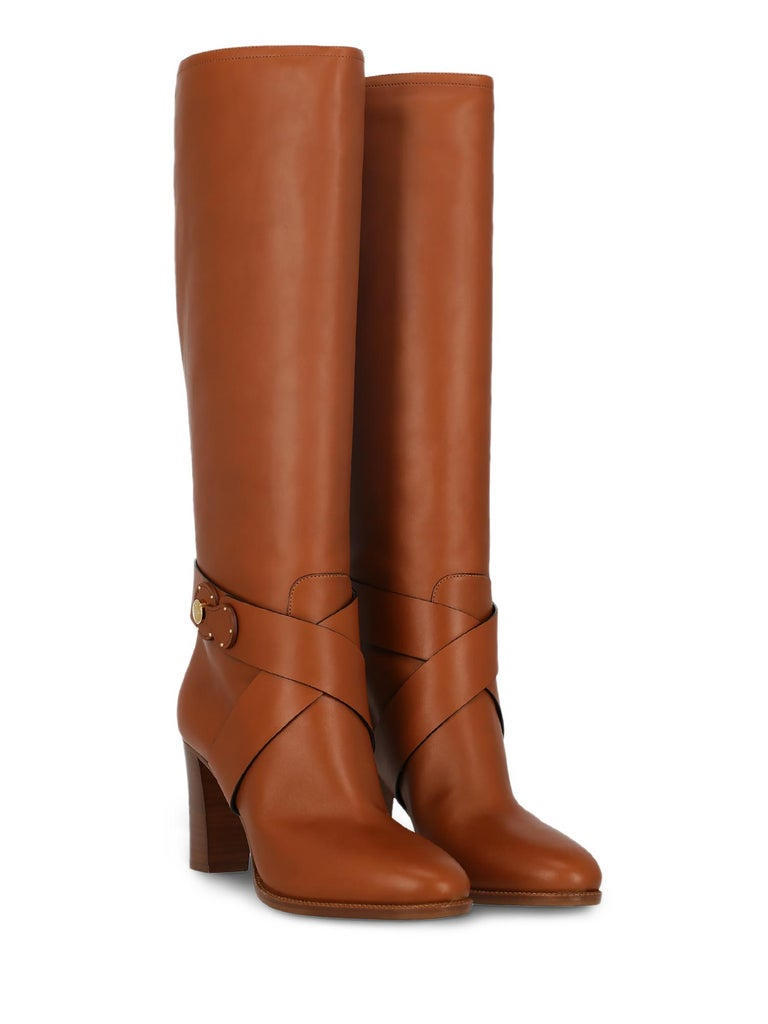 Boots, leather, solid color, knee-length, side logo, gold-tone hardware, branded sole, mid heel. Product Condition: Excellent. Sole: negligible marks